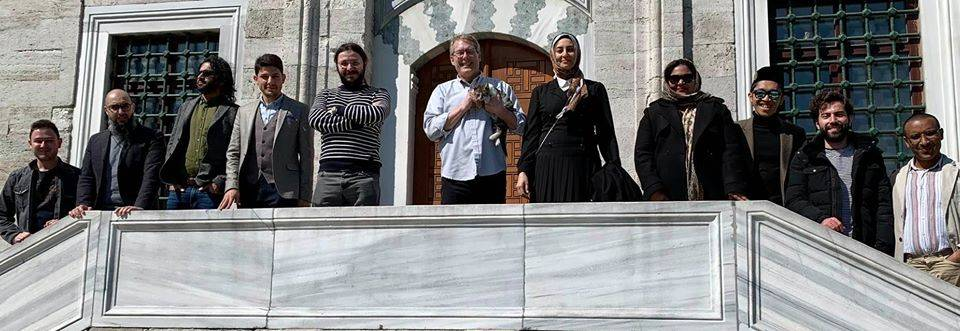 Group shot in front of mosque